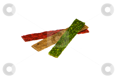 Dog Treat stock photo, Red, green and yellow dog treats isolated on the white background by Petr Koudelka
