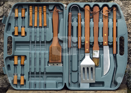 Barbecue cutlery stock photo, Detail of a set of cutlery used for barbecues by Petr Koudelka
