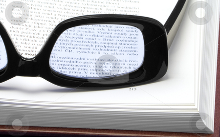 Glasses on a book stock photo, Glasses (eyewear) on a book - close-up by Petr Koudelka