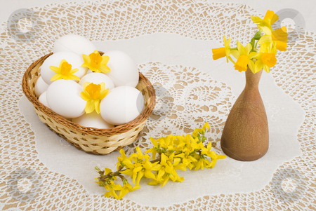 Easter stock photo, A basket of eggs, forsythia and yellow daffodils by Petr Koudelka