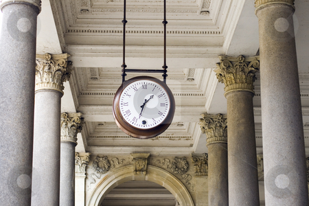Clock  stock photo, A clock hanging among pillars in the spa colonnade by Petr Koudelka