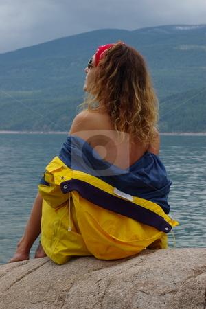 Rain coats stock photo, Semi nude female fashion model wearing a yellow rain coat by Rick Olson