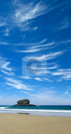 Blue sky and wispy white clouds above Gull Rock in Portreath, Cornwall UK. stock photo, Blue sky and wispy white clouds above Gull Rock in Portreath, Cornwall UK. by Stephen Rees