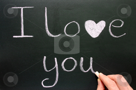 Writing I love you with pink chalk. stock photo, Writing I love you with pink chalk. by Stephen Rees