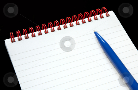 Notepad with red rings and a blue pen on a black background. stock photo, Notepad with red rings and a blue pen on a black background. by Stephen Rees