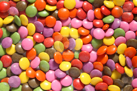 Lots of colorful smarties. stock photo, Lots of colorful smarties. by Stephen Rees