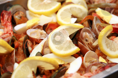 Seafood paella 2 stock photo, Close-up of seafood paella with lots of lemon toppings by Jonas Marcos San Luis