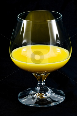 Glass of Eggnog stock photo, A glass of eggnog on the white background by Petr Koudelka