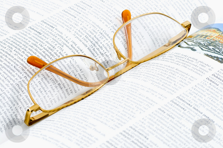 Glasses on a Book stock photo, Glasses lying on an open book - close up by Petr Koudelka