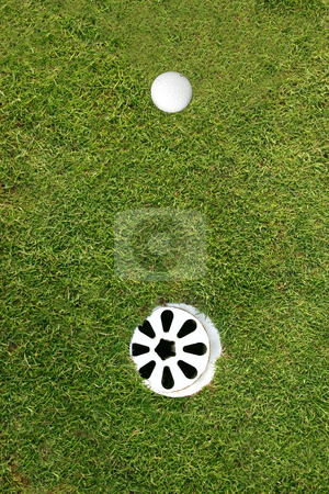 Golf ball waiting for a short put stock photo, Golf ball waiting for a short put by Stephen Rees
