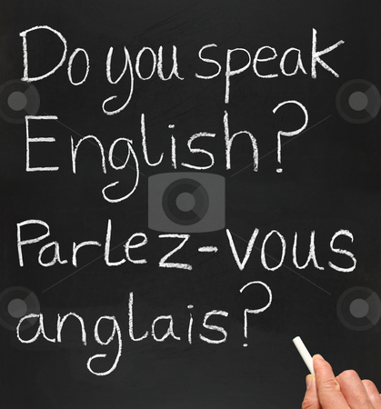 Do you speak english? stock photo, A teacher writing do you speak english in French. by Stephen Rees