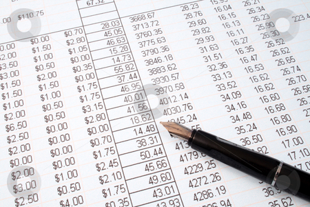 Reviewing the accounts on a printed spreadsheet. stock photo, Reviewing the accounts on a printed spreadsheet. by Stephen Rees