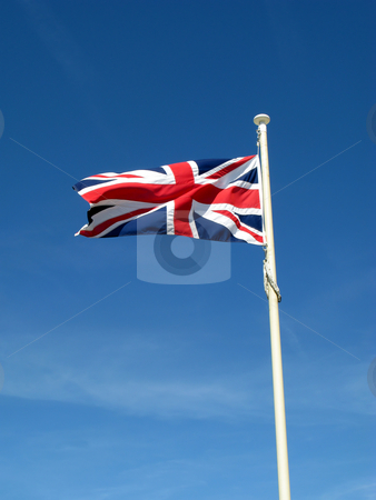 The Union Flag of Great Britain blowing in the wind. stock photo, The Union Flag of Great Britain blowing in the wind. by Stephen Rees