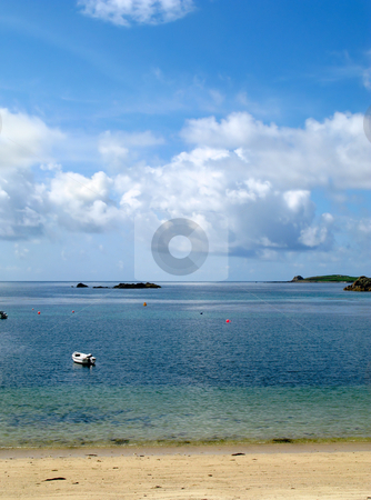 White clouds and blue sky over a calm sea, Porthcressa St. Mary's Isles of Scilly. stock photo, White clouds and blue sky over a calm sea, Porthcressa St. Mary's Isles of Scilly. by Stephen Rees