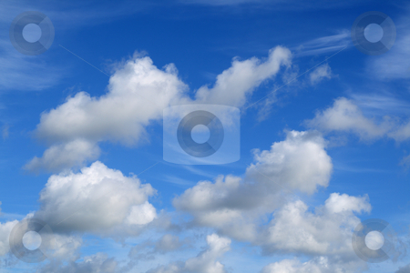 White fluffy clouds in a blue sky. stock photo, White fluffy clouds in a blue sky. by Stephen Rees