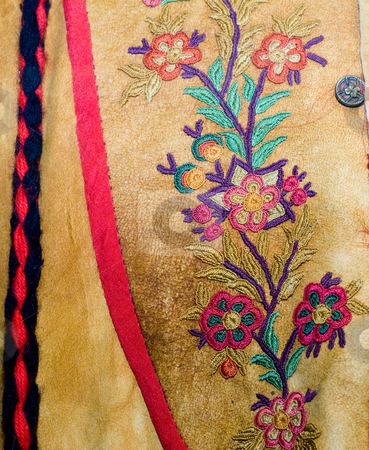 Closeup Native Clothing stock photo, Closeup view of a floral pattern stitched into native american clothing by Richard Nelson