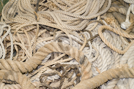 Pile of Ropes stock photo, Various sizes of ropes piled on the ground by Richard Nelson