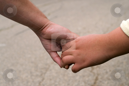 Holding Hands stock photo, Closeup view of a mother and daughter holding hands by Richard Nelson