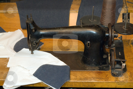 Antique Sewing Machine stock photo, An antique sewing machine sitting on a wooden table by Richard Nelson