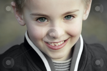 Innocent kid stock photo, Happy smiling innocent child with chubby cheeks and perfect blue eyes by Claudia Veja
