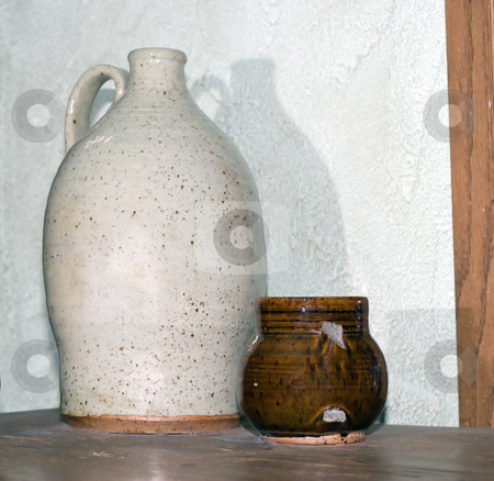 Old Jug and Cup stock photo, An old jug and a brown chipped cup, shot indoors by Richard Nelson