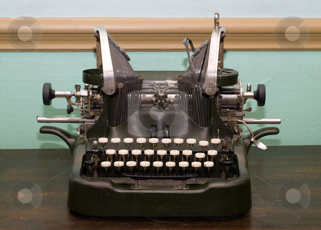 Antique Type Writer stock photo, An antique type writer sitting on a wooden table by Richard Nelson