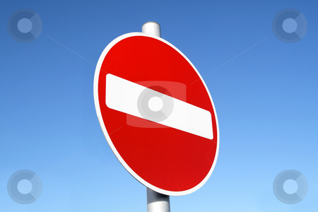 Red and white british no entry road sign with a blue sky. stock photo, Red and white british no entry road sign with a blue sky. by Stephen Rees
