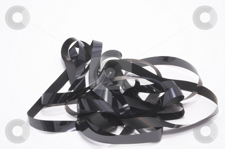 Video Tape stock photo, A blank section of video tape in a pile. by Robert Byron