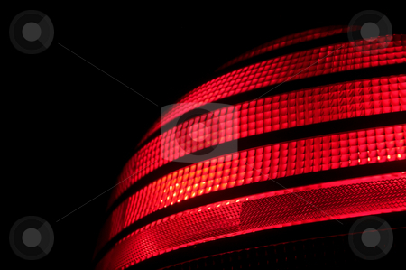 AutomobileTail Light stock photo, A red plastic automobile tail light signal. by Robert Byron