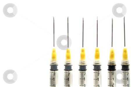 Syringes stock photo, A set of lined up medical syringes. by Robert Byron