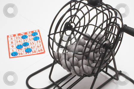 Bingo Cage and Card stock photo, A bingo cage, balls with numbers, card and markers. by Robert Byron