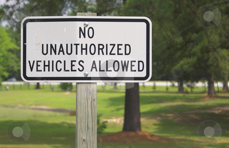 No Unauthorized Vehicles Allowed stock photo, A sign stating No Unauthorized Vehicles Allowed. by Robert Byron