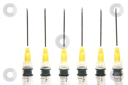 Syringes stock photo, A set of medicall syringes ready for medications. by Robert Byron