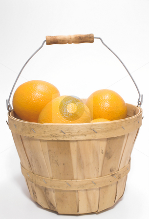Oranges in a Basket stock photo, Delicious oranges in a wooden bushel basket. by Robert Byron