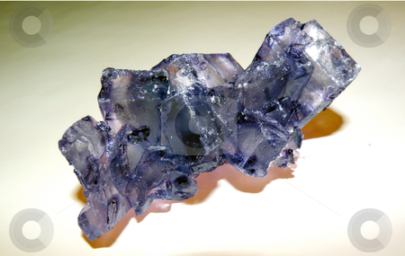 Purple rock candy stock photo, A string of purple rock candy by Rob Wright