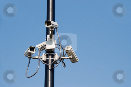 Security Cameras stock photo, A series of security cameras on a pole. by Robert Byron
