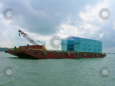 Barge in open sea stock photo,  by ZaKaRiA- MaStErPiEcE