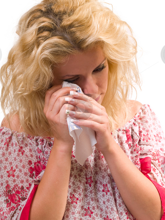 Tear woman stock photo, Sad blond woman wiping her tears with a napkin by Adrian Costea