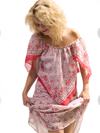 Woman holding dress stock photo, Blond woman holding her dress up by Adrian Costea