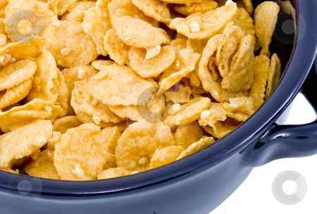 Bowl of Cornflakes stock photo, A blue bowl of dry cornflakes - healthy diet by Petr Koudelka