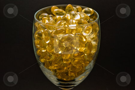Vitamin E Softgels stock photo, Abstract of vitamin e softgels capsules by Robert Cabrera