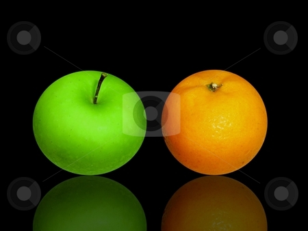 Apple and orange on black glass stock photo,  by ZaKaRiA- MaStErPiEcE