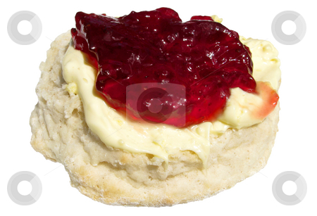 Strawberry jam and clotted cream on a scone. stock photo, Strawberry jam and clotted cream on a scone. by Stephen Rees
