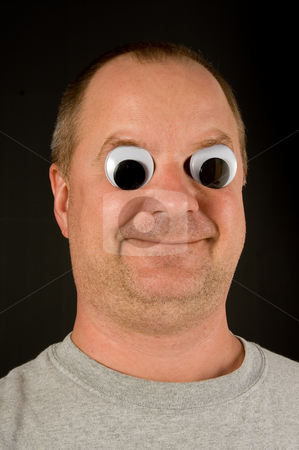 Silly Man stock photo, A silly man with wiggly googly eyes. by Robert Byron