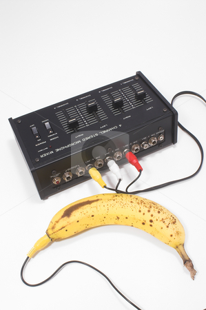 Mixed Fruit stock photo, A sound mixer plugged in to a banana. Mixed fruit concept. by Robert Byron