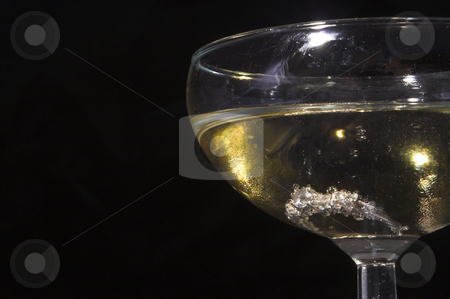 Engagement Ring in Champagne stock photo, An engagement ring in a glass of champagne. by Robert Byron