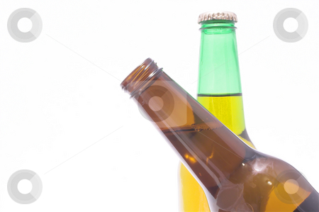 Crossing Beer Bottles stock photo, A couple of beer bottles, one crossing in front of the other. by Robert Byron