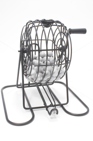 Bingo Cage stock photo, A bingo game cage with numbered balls. by Robert Byron