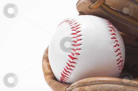 Baseball and Baseball Glove stock photo, A baseball inside of a baseball glove. by Robert Byron