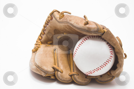 Baseball and Baseball Glove stock photo, A baseball inside of a baseball glove. by Robert Byron
